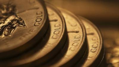 Vàng thế giới giảm khi đồng USD mạnh và lợi suất trái phiếu khởi sắc